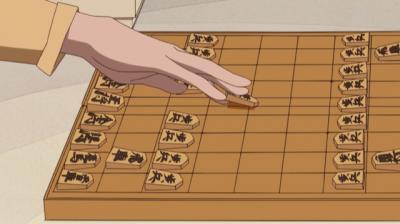 将棋を指す玉瀾の手